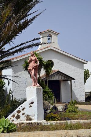 La Oliva, Fuerteventura, Spain - April 01, 2017: Sculpture and chapel named Hermita en La Oliva in the tiny village on Canary island