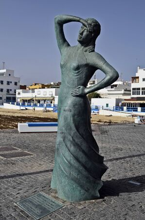 Corralejo,  Fuerteventura, Spain - April 02, 2017: Sculpture of Monumento al Marinero on harbor of the city in Canary Island