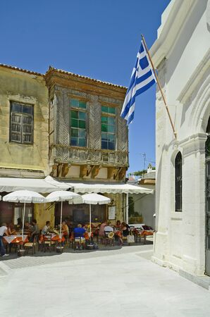 Rethymno, Greece - May 22nd 2014: Unidentified people in restaurant and home with turkish balcony