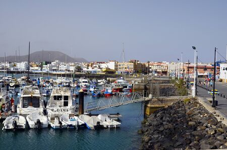 Corralejo,  Fuerteventura, Spain - April 02, 2017: Unidentified people and different boats in yacht harbor of the city on Canary Island