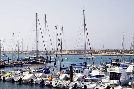Corralejo,  Fuerteventura, Spain - April 02, 2017: Different boats in yacht harbor of the city on Canary Island