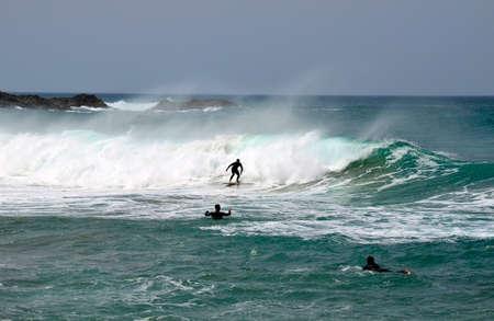 Fuerteventura, Spain - April 01, 2017: Unidentified surfer in atlantic ocean, preferred watersport on Canary islands Editorial