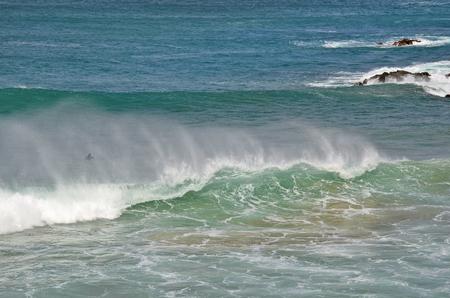Spain, Canary Island, Fuerteventura, El Puerte de Los Molinos, surfer and waves in atlantic ocean