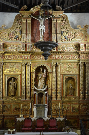 Betancuria, Canary Island, Spain - March 30, 2017: Altar in medieval church of Saint Mary aka Iglesia de Santa Maria, landmark and tourist attraction in the village Editorial