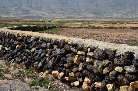 oliva: Spain, Canary Island, Fuerteventura, La Oliva, traditional wall and fenz built with stones and without binder Stock Photo