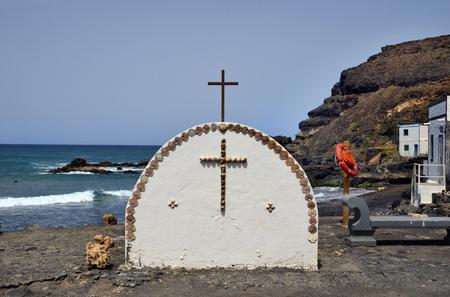 Spain, Canary Island, Fuerteventura, wayside shrine decorated with mussels in village El Puerte de Los Molinos,