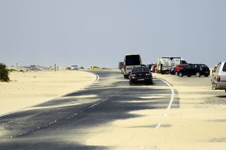 Fuerteventura, Canary Islands, Spain - March 31, 2017: Sandstorm over coastel road with different cars