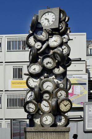 Paris, France - June 03, 2011: Sculpture with different clocks, reminiscence for time