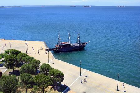 Greece, Thessaloniki aka Saloniki, view from medieval White Tower with cruising ship on Aegean sea Stock Photo