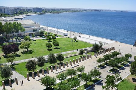 Thessaloniki, Greece - June 09, 2017: View from White Tower to parks, monuments and promenade along Aegean sea