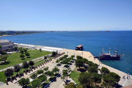 Thessaloniki, Greece - June 09, 2017: Cityscape and cruising ship on promenade along shore of Aegean sea
