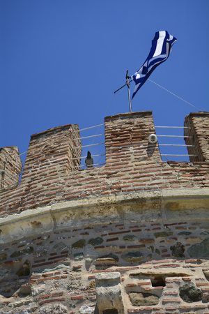 Greece, Thessaloniki aka Saloniki, battlements, raven and Greek flag on top of Withe Tower