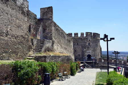 Thessaloniki, Greece - June 09, 2017: Unidentified people and walls of medieval castle on hill of the city in Central Macedonia Editorial