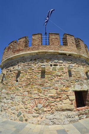 Greece, Thessaloniki aka Saloniki, battlements and Greek flag on top of Withe Tower