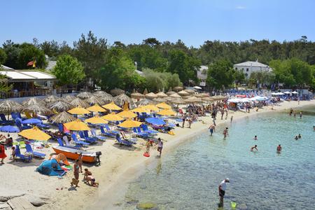 Aliki, Greece - June 10, 2017: Unidentified people on Aliki beach, preferred travel destination on Thassos island