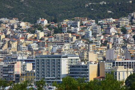Kavala, Greece - June 15, 2017: Cityscape with different building, hotel and church of the city in East Macedonia