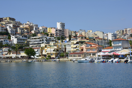 Kavala, Greece - June 15, 2017: Boats and restaurants in the tiny harbor of Perigiali
