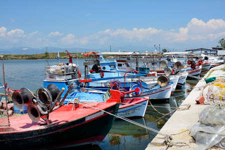 Keramoti, Greece - June 15, 2017: Fishing boats in the harbor of the village in East Macedonia