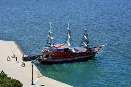 Thessaloniki, Greece - June 09, 2017: Cruising ship on promenade along shore of Aegean sea