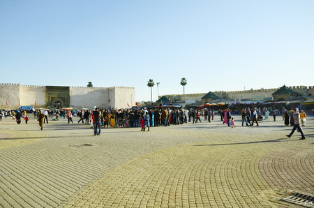 Meknes, Morocco - November 19th 2014: Unidentified crowd of people on place el-Hedim, importand square where different street artists, snake chambers and others perform