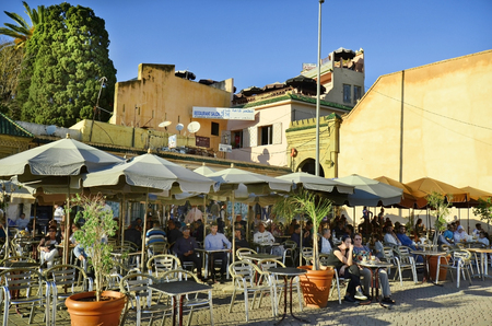 Meknes, Morocco - November 19th 2014: Unidentified people relax in a restauarant and coffee shop on a square in the old district