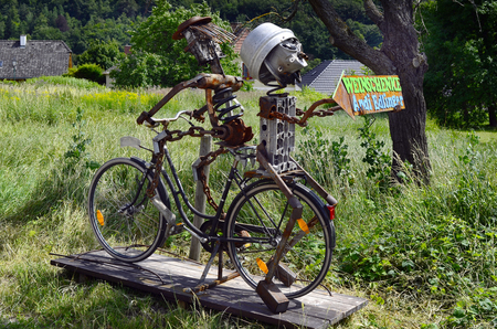 Duernstein, Austria , funny sculpture with bicycle ond old tools as sign to a tavern (named Heuriger aka Weinschenke in Austria) in the Unesco World Heritage site in Danube valley