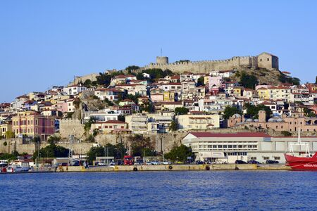 Kavala, Greece - June 12, 2017: Cityscape with medieval fortress, Imaret, homes and ferry in the harbor of the city on Aegean sea in Eastmacedonia Editorial