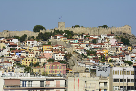 Kavala, Greece - June 13, 2017: Cityscape with medieval castle and fortified wall in the city on Aegean sea
