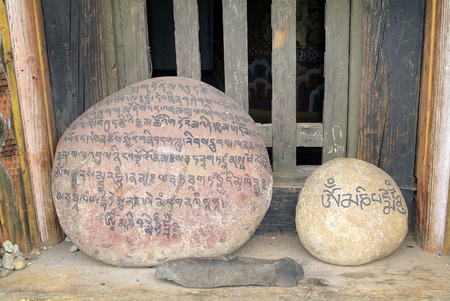 Bhutan, Mani Stone in Wangduchoeling Palace lettered with the - Om mani padme hum- prayer