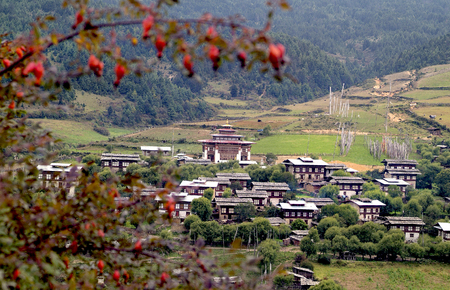 Bhutan, mountain village Ura with homes and traditional Dzong