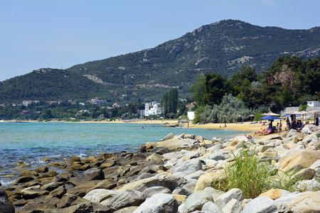 Kavala, Greece - June 14, 2017: Unidentified people on sandy Palio beach on Aegean sea Editorial