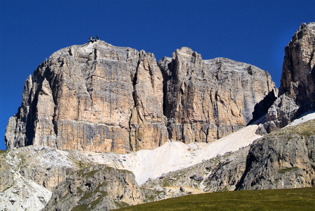 Rock formation with summit station of the cable car to Sas de Pordoi, Italy.