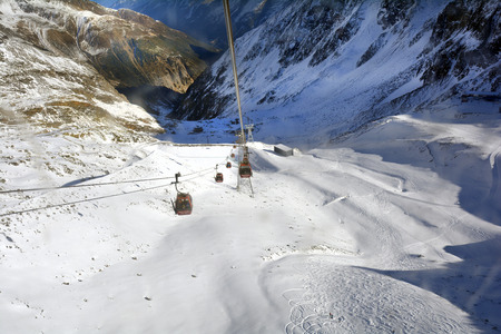 Stubei, Austria - : Cable car and intermediate station  in winter sports area of Stubaier glacier in Austrian Alps