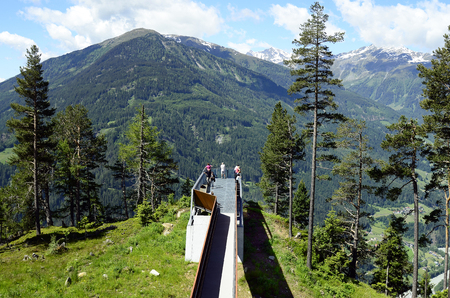 Kaunergrat, Tyrol - June 22, 2016: Unidenified people on viewing point named Gacher Blick with Austrian Alps and Inn-valley