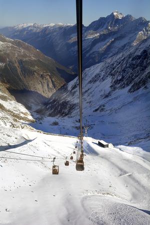 Stubei, Austria - December 20, 2015: Cable car and intermediate station  in winter sports area of Stubaier glacier in Austrian Alps