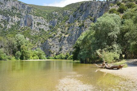 Greece, Nestos River Gorge with tunnel of Drama - Xanthi railway and foot path along the river