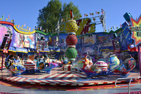 Linz, Austria - October 02, 2015: Amusement park with carousel on yearly funfair on bank of  Danube river