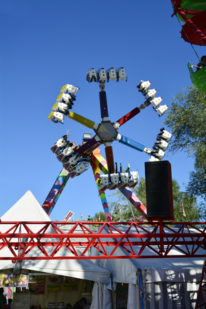 Linz, Austria - October 02, 2015: Amusement park on yearly funfair on bank of  Danube river