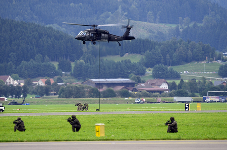 Zeltweg, Styria, Austria - September 02, 2016:  Field exercise with S-70 Black Hawk helicopter by public  and entrance free airshow named airpower 16 Editorial