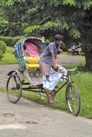 Dhaka, Bangladesh - September17th 2007: Uidentified young man with his poorly looking rickshaw, a traditional kind of transport Redakční