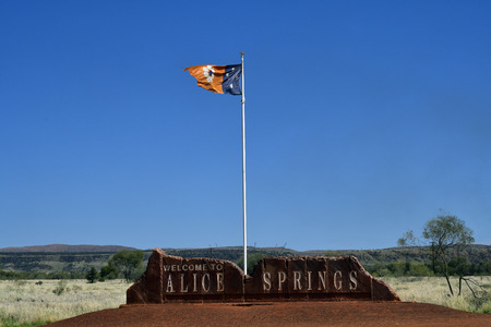 Australia, welcome from Alice Springs with flag from Northern Territory Editorial