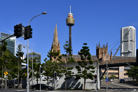 Sydney, NSW, Australia - October 28, 2017: St. Mary Cathedral, Sydney Tower aka Centrepoint Tower, building and railway bridge