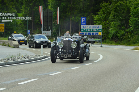 Nassereith, Tirol, Austria - June 27, 2014: Unidentified people in vintage car Bentley roadster by motorsport event on Fernpass road