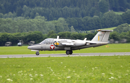 Zeltweg, Styria, Austria - July 01, 2011:  Saab 105 fighter jet from Austrian airforce by public airshow named airpower 11