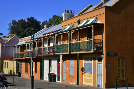 Different colorful houses with balconies built in old style Stock Photo