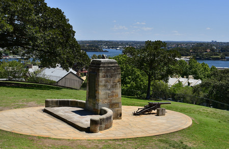 Australia, memorial and cannon in park of public Sydney observatorywith view to Parramatta river