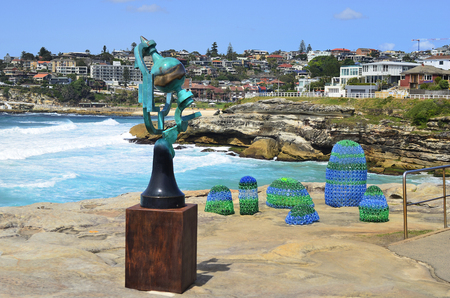 Sydney, NSW, Australia - October 31,2017: Sculpture by the sea - an outdoor exhibtion along the coast at Bondi, Song of the Aisors from artist Jock Clutterbuck and Plastic Paradise from Kathy Allam