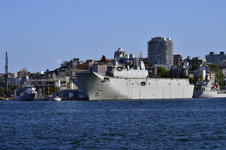 Sydney, NSW, Australia - October 29, 2017: Warships HMAS Canberra, a helicopter carrier and HMAS Stuart frigate in Wooloomooloo harbor