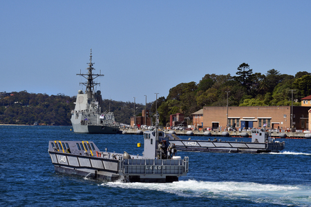 Sydney, NSW, Australia - October 31, 2017: HMAS Hobart in Wooloomooloo wharf and exercise with landing crafts of the Royal Australian navy