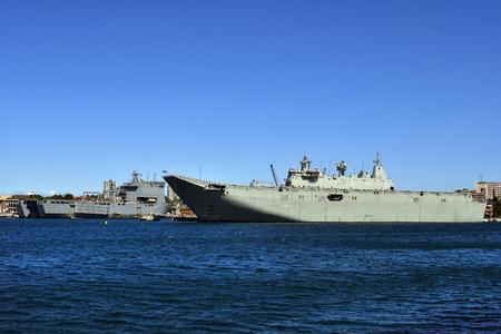 Sydney, NSW, Australia - October 31, 2017: Warships of Royal Australian Navy HMAS Canberra and HMAS Choules at Wooloomooloo wharf,